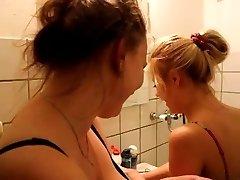 Towheaded gilr in bathroom