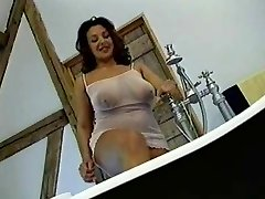 British Busty MILF gets penetrated in the bathroom