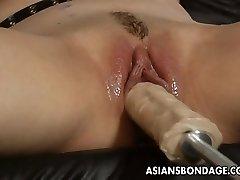 Mind-blowing blonde bi-atch dominates the slut with a fuck machin