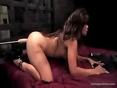 Brunette gets in different postures to let this machine fuck her