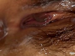 Young Asian babe receives a fluid filled cootchie