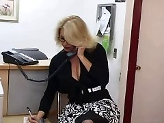 Mature secretary gets cum on her giant tits