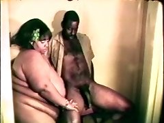 Big fat gigantic black bitch loves a hard black cock inbetween her lips and legs