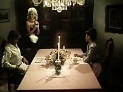 Antique maid blows knobs under the table