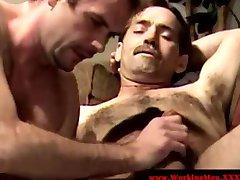 Gay bear gets pals blowjob on the sofa
