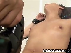 Asian babe bond and fuckd by a nailing machine