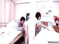 Beautiful Japanese nurse gives a patient some part3