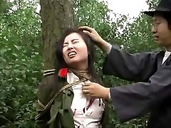 Asian army girl strapped to tree 1