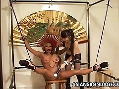 Restrained Asian chick tortured by her smoking hot dominatrix