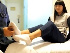 asian kittle girl with sock and bare