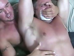 A Beefy Bodybuilder is Tied Up and Jerked by His Gym Buddy
