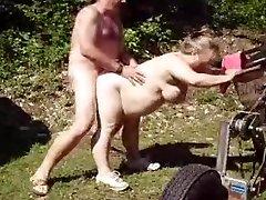 Poking mature wife in garden