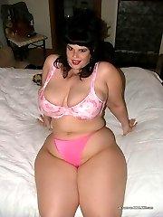 Shaved brunette plumper in her kinky lingerie