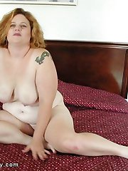 Hot fat red head fingers her juicy pussy