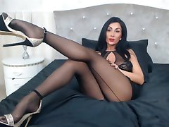 Gorgeous brunette MILF masturbating in high heels