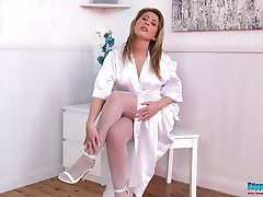 Sexy redhead nurse Sophie Star posing seductively in white nylon stockings