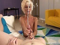 Sluty Mature Lady Jerks Off A Young Guy