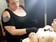 punk girl gets her nipple pierced
