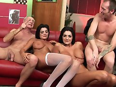 Smoking hot babes get fucked side by side on the sofa