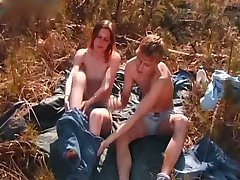 Young couple make love outdoor in the woods