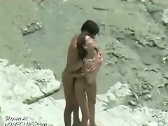 Couple fucking: beach voyeur video