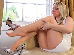 sleek blonde bride teasing on sofa