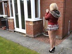 Mature neighbor walks with short skirt and bare ass outdoors