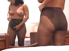 Busty MILF fingering her pussy in pantyhose