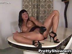 Busty horny slut working on a huge dildo part1