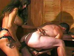 Brunette Mistress Fucks Male Slave with Strapon