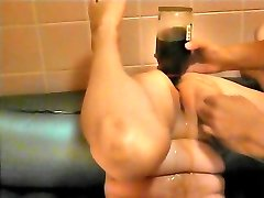 Insert the brandy bottle in anal invasion