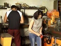 Dark Haired Gangbanged in Workshop