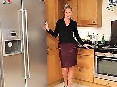 Blonde model in kitchen teasing hard