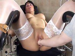 Hot milf slut in a medical chair