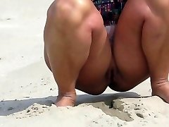 Desnuda en la playa en Holanda