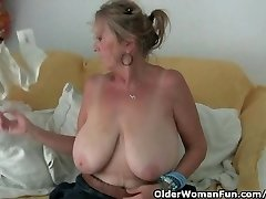 Granny with big titties masturbates in hose