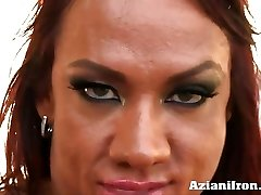 Amber crushes her vulva with thick dildo
