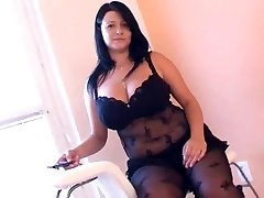 Fat girl in arousing black undergarments