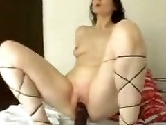 Slutty wench rides her huge black faux-cock masterfully like it is a real thing