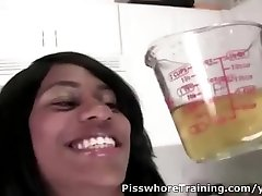 Black babe pissed in the cup