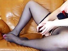 Russian phat girl fucks herself with a big ebony dildo
