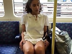 Plucky Public Upskirt Showing on a Train