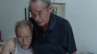 Chinese old men comparing schlongs