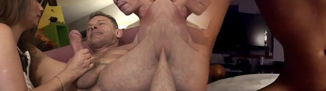 Large stud is feeding husband and wife with his fat rod...