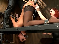 Hot and willing Cassandra wants to get pushed as hard as she can take it. Today is no exception. In a no holds live shoot there is no recanting, breaks, moments she can catch her breath. Nothing. She submits and she endures.First, our bitch du jour is bound in a chair style position as Asa Archer is bound in a standing spread eagle watching. A tall and severe metal neck collar keeps Cassandra tightly in position. Claire adds to the predicament by adding nose and mouth hooks. When Cassandra tries to close her mouth, it pulls on both hooks. Mean clover clamps are added to Cassandra's labia and then attached to another set at her nipples. Claire and Mz take turns tormenting and administering pain until immense squirting orgasms are wrenched from this more than eager to cum whore.Next, Cassandra's head is bifurcated and trapped under the neck stockade she is kneeling on, with her arms in a very strict strappado. The worst thing about the bifurcation game is never knowing when the pain is going to come and always breaks even the toughest girls. Cassandra crumbles from fear, as expected but its incredibly hot to watch her try and maintain composure over the hell she is enduring. Claire canes and single tails while Mz plays the