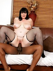 BBW car salesperson in fishnets earns herself a good deal by fucking black cock
