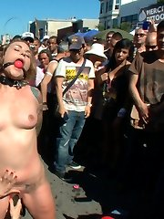 Payton Bell hands are cuffed behind her back as she is lead into the crowd at Folsom Street Fair with an electric butt plug up her ass. People take turns holding the remote control and shocking the hell out of our little submissive's butthole while she is caned, spanked, and fondled. Next she gets zippered for the first time ever right in the middle of the street. The clothespins run from the top of her tits all the way down to her sensitive pussy lips. The crowd cheers as the zipper is slowly ripped off her body and she screams in shock and pain. Finally she is rewarded with a strong orgasm and multiple cocks to suck and fuck. Watch and enjoy as Payton is transformed from a sweet girl next door to a cock hungry bondage whore!