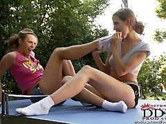 Sporty babes sucking feet!
