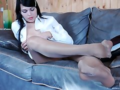 Lewd business-girl in velvety hose going for pussy-stroking and feet-fondling