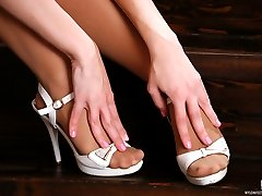 Cute blondie in pink flashes her soft feet in sheer hose and heeled sandals